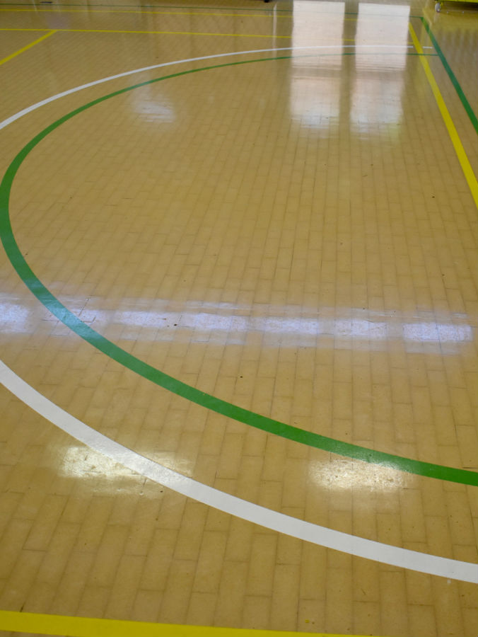 Close up of sports hall floor after sand and re-painted court markings